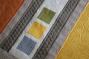 close up of quilting designs