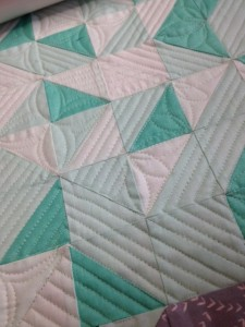 quilting on half square triangle blocks
