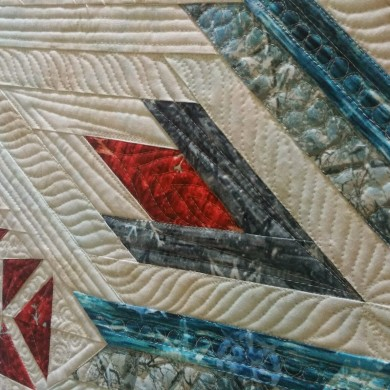 contrasting machine quilting designs
