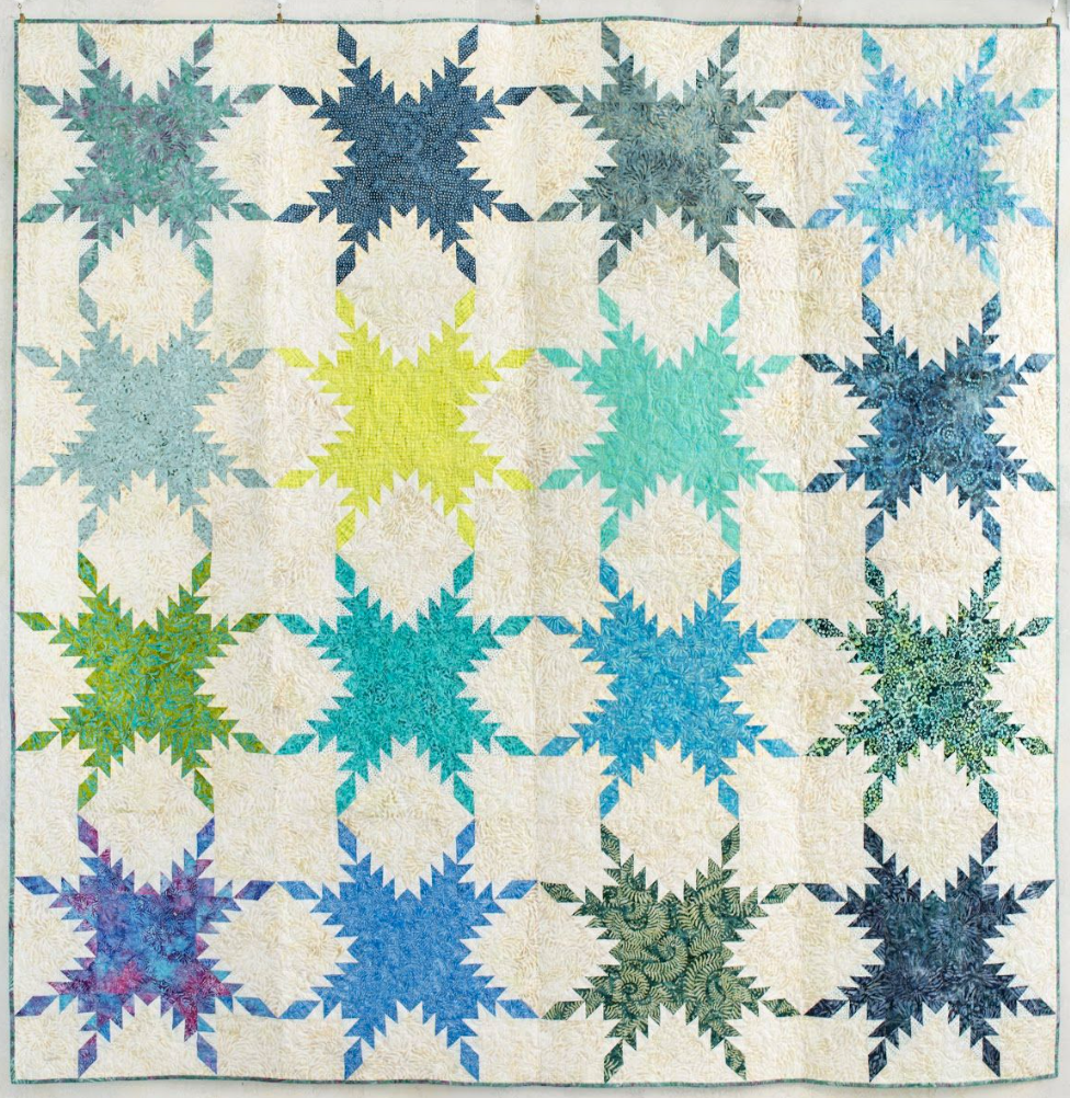 surfer point feathered star quilt