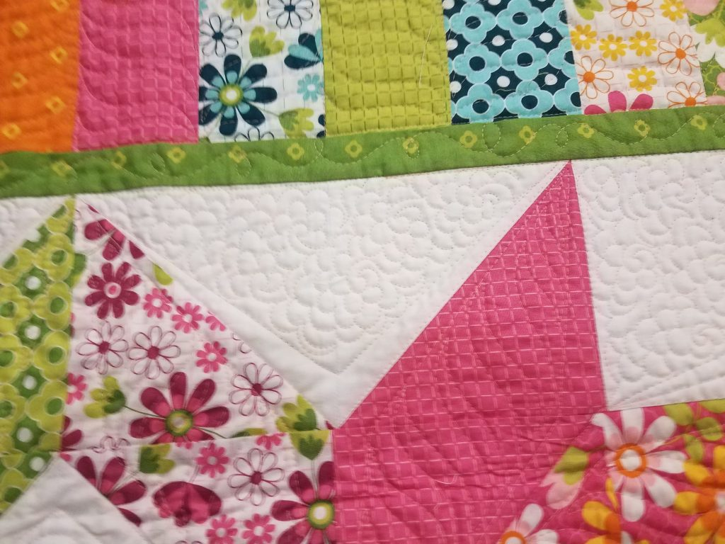 flower meander quilting design on a carpenters star