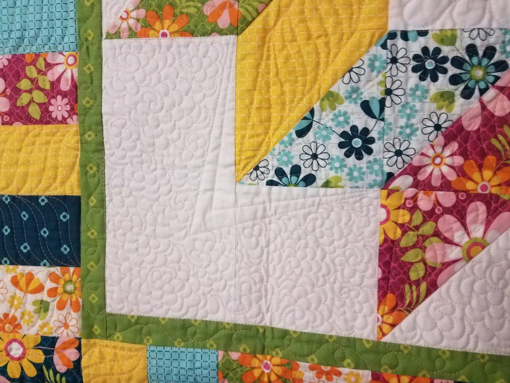 flower meander quilting design on star quilt